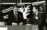 President Ronald Reagan at the NIST superconductivity display, part of the conference he initiated for scientists and...